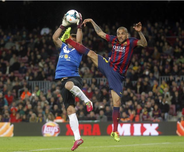 Barcelona's Dani Alves fights for the ball against Almeria's Suarez during their Spanish first division soccer match at Camp Nou stadium in Barcelona