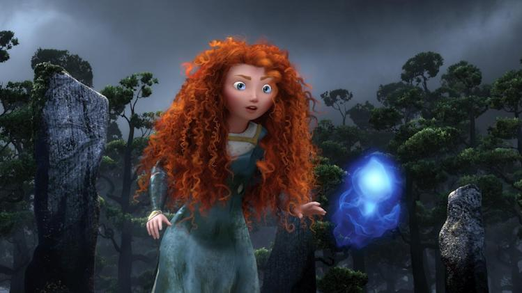 "FILE - In this undated file film image released by Disney/Pixar, the character Merida, voiced by Kelly Macdonald, follows a Wisp in a scene from ""Brave."" ""Brave,"" ""Wreck-It Ralph"" and ""Rise of the Guardians"" are among the animated features angling for an Oscar nomination. The motion picture academy said Friday, Nov. 2, 2012, that 21 films have been submitted for consideration in the Academy Awards' animated feature category. (AP Photo/Disney/Pixar, File)"