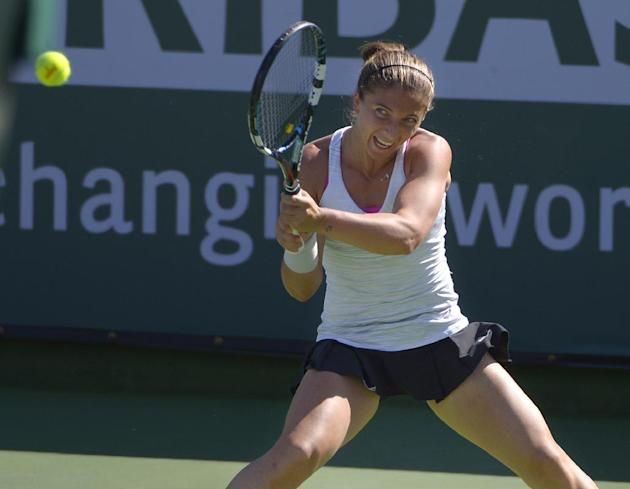 Sara Errani, of Italy, makes a return to Eugenie Bouchard, of Canada, during a match at the BNP Paribas Open tennis tournament on Sunday, March 9, 2014, in Indian Wells, Calif