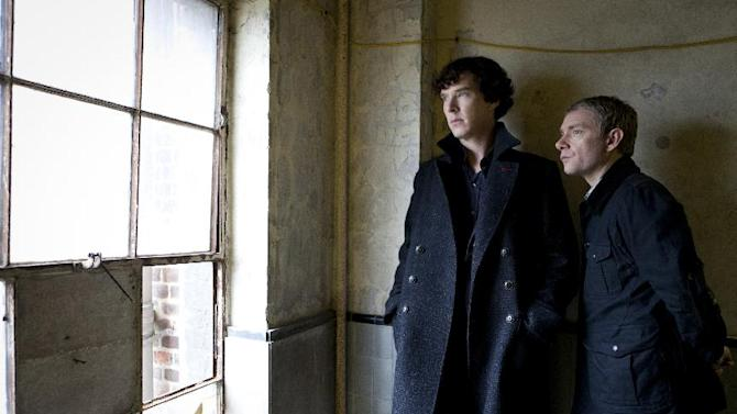 """This image released by PBS shows Benedict Cumberbatch as Sherlock, left, and Martin Freeman as Watson are shown in the """"Sherlock: A Scandal in Belgravia"""". Cumberbatch was nominated Thursday, Dec. 13, 2012 for best actor in a TV movie or miniseries for his role in the film. The 70th annual Golden Globe Awards will be held on Jan. 13. (AP Photo/PBS-Hartwood Films for the BBC, Colin Hutton)"""