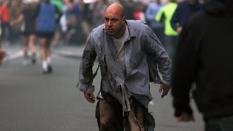 FILE - In this photo provided by The Daily Free Press and Kenshin Okubo, a man whose clothes were shredded walks away from the scene of two explosions at the 2013 Boston Marathon in Boston on Monday, April 15, 2013. (AP Photo/The Daily Free Press, Kenshin Okubo) MANDATORY CREDIT: THE DAILY FREE PRESS, KENSHIN OKUBO