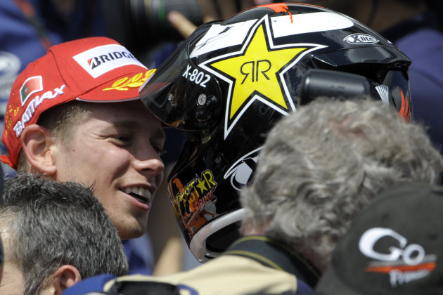 Repsol Honda team's Australian Casey Stoner (L) is congratulated by Yamaha Factory Racing team's Jorge Lorenzo (R) after wining the Moto GP race of the Portuguese Grand Prix in Estoril, outskirts of L