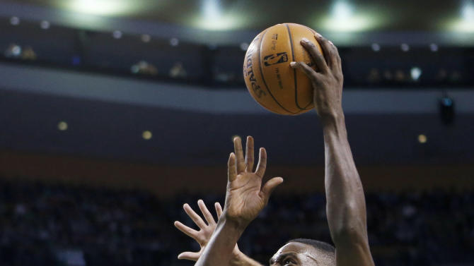 Boston Celtics' Jeff Green (8) shoots over Miami Heat's Shane Battier (31) in the first quarter of an NBA basketball game in Boston, Monday, March 18, 2013. (AP Photo/Michael Dwyer)