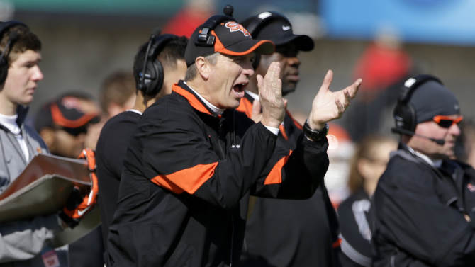 Sam Houston State head coach Willie Fritz cheers on his team in the first half of the FCS Championship NCAA college football game against North Dakota State, Saturday, Jan. 5, 2013, in Frisco, Texas. (AP Photo/Tony Gutierrez)