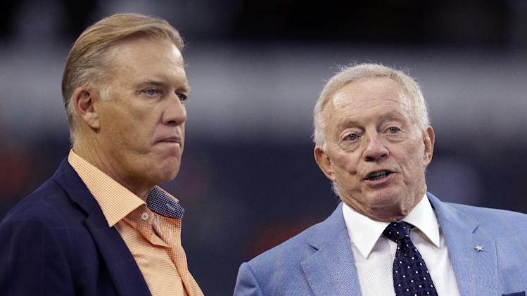 John Elway, Executive Vice President of Football Operations and General Manager of the Denver Broncos, left, talks with Dallas Cowboys team owner Jerry Jones, right, before a NFL preseason football game, Thursday, Aug. 28. 2014, in Arlington, Texas