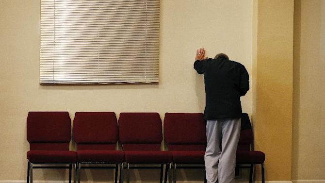 Randy Scroggins, a pastor at New Beginnings Church of God, cries in his church Saturday, Oct. 3, 2015, in Roseburg, Ore. Scroggins had just spoke on the phone with the mother of a man who was shot and killed by Chris Harper Mercer while he was near his daughter Lacey Scroggins at Umpqua Community College Thursday. (AP Photo/John Locher)