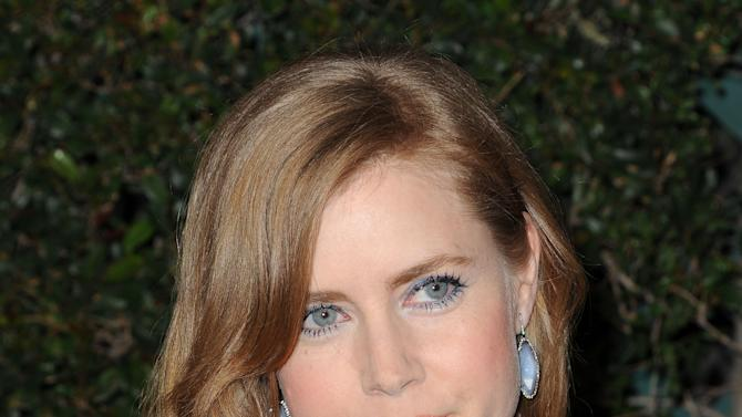 "FILE - In this Feb. 20, 2011 file photo, actress Amy Adams arrives at Vanity Fair Campaign Hollywood at Siren Studios in Los Angeles. Adams, who played a princess in the film ""Enchanted,"" will be returning to fairy tales this summer, starring opposite Cinderella and a witch. The Public Theater said Tuesday, April 3, 2012, that the three-time Academy Award nominated actress will play The Baker's Wife in its production of Stephen Sondheim's and James Lapine's ""Into the Woods."" (AP Photo/Katy Winn, file)"