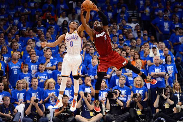 Russell Westbrook #0 Of The Oklahoma City Thunder And Dwyane Wade #3 Of The Miami Heat Battle For A Ball In The Getty Images