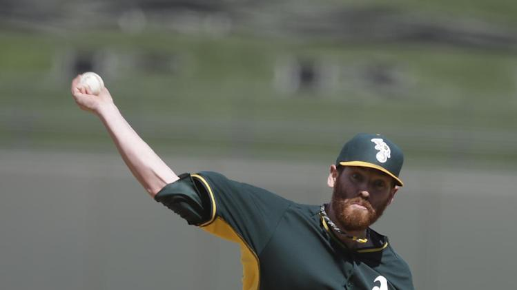 Oakland Athletics starting pitcher Dan Straily throws during a spring exhibition baseball game against the Kansas City Royals Friday, March 14, 2014, in Surprise, Ariz. (AP Photo/Darron Cummings)