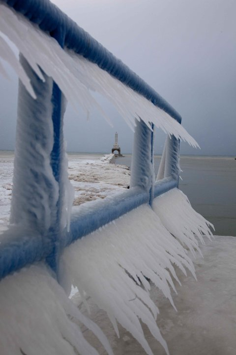 Icicles form on a walkway along Lake Michigan in Port Washington, Wi., Tuesday, Feb. 1, 2011, in Milwaukee. (AP Photo/Jeffrey Phelps)