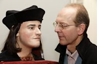Michael Ibsen (R), a descendant of England's king Richard III, with a plastic model based on a CT scan of Richard's skull, during a press conference in London on February 5, 2013. The face of England's much-maligned Richard III was revealed on Tuesday for the first time in 500 years on Tuesday following a reconstruction of his skeleton which was found buried underneath a car park