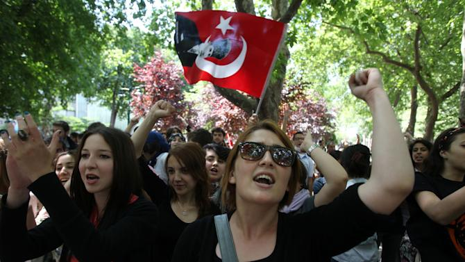 High school students chant slogans during a protest at Gezi park, Taksim square in Istanbul, Monday, June 3, 2013. The demonstrations that grew out of anger over excessive police force have spiraled into Turkey's biggest anti-government demonstrations in years, challenging Prime Minister's Recep Tayyip Erdogan power. (AP Photo/Thanassis Stavrakis)