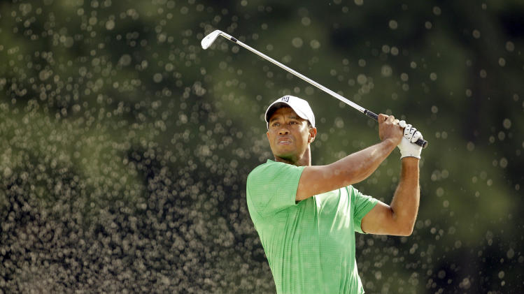 Tiger Woods watches his shot out of a sand trap on the 11th fairway during the second round of the Wells Fargo Championship golf tournament at Quail Hollow Club in Charlotte, N.C., Friday, May 4, 2012. (AP Photo/Chuck Burton)