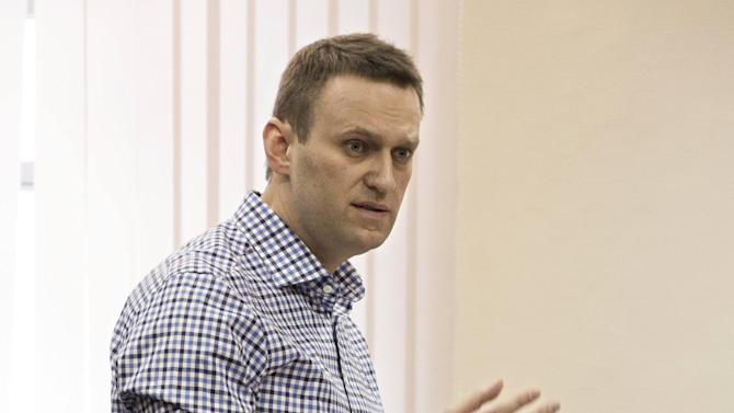 Russian opposition leader Alexei Navalny, standing, speaks in a court room in a Kirov court, as his former colleague Pyotr Ofitserov, left, looks on, Thursday, April 25, 2013. The trial has resumed in the case against Navalny who led protests against President Vladimir Putin and exposed alleged corruption in his government. (AP Photo/Yevgeny Feldman)