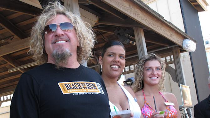 Singer Sammy Hagar poses for a photo at his beach bar in Atlantic City N.J., Friday, May 18, 2012. The former Van Halen singer says he's not surprised the band's tour with David Lee Roth appears to be falling apart, with dozens of dates postponed. He says brothers Eddie and Alex Van Halen are extremely hard to get along with, adding he didn't think the tour would last as long as it has. (AP Photo/Wayne Parry)