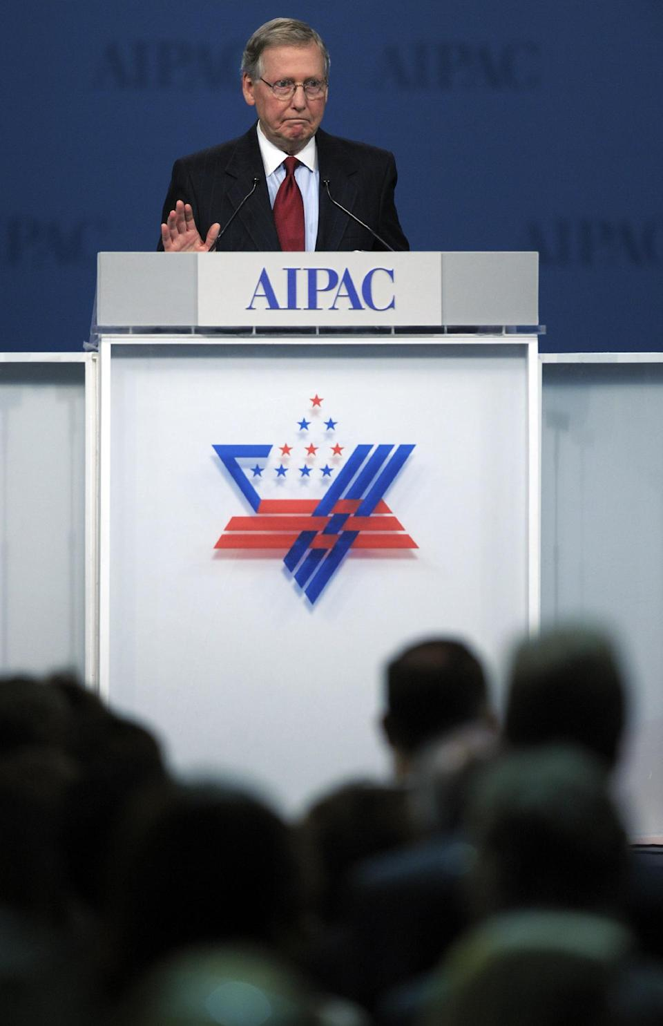Senate Minority Leader Mitch McConnell, R-Ky., reacts to a standing ovation as he addresses the American Israel Public Affairs Committee (AIPAC) Policy Conference opening plenary session in Washington, Monday, March 5, 2012. (AP Photo/Cliff Owen)