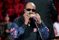 "Singer Stevie Wonder performs the National Anthem on a harmonica at the 2005 NBA Finals. ""When I heard Stevie Wonder, I said, 'Jesus, that instrument can do. I love that sound',"" Adam Glasser said"