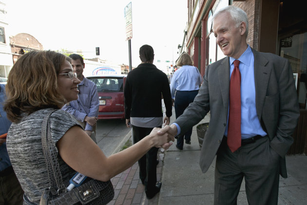Democratic senate candidate Bob Kerrey, right, campaigns in the Benson neighborhood of Omaha, Neb., Tuesday, May 15, 2012. Kerrey, who is running for the U.S. senate seat vacated by democrat Ben Nelson, will face the winner in the republican primary election. (AP Photo/Nati Harnik)