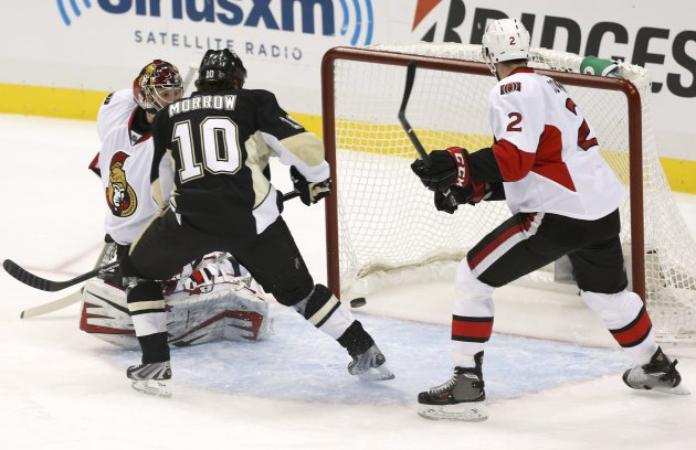 Penguins' Morrow scores on Senators goalie Anderson as Senators' Cowen watches during the first period in Game 5 of their NHL Eastern Conference semi-final hockey series in Pittsburgh