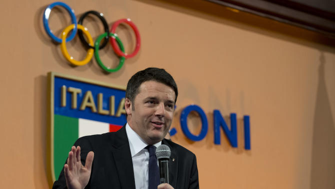 """Italian Premier Matteo Renzi delivers his speech at Italian Olympic Committee headquarters in Rome, Monday, Dec. 15, 2014. Renzi says Rome will bid for the 2024 Summer Olympics. He says """"the Italian government, together with CONI, is ready for this project."""" The move comes with Italy's economy still stagnant and amid a widening corruption and mafia scandal in the capital. Italy planned to bid for the 2020 Olympics but the project was scrapped after then-premier Mario Monti refused to provide financial backing. The 2024 host will be chosen in 2017. (AP Photo/Andrew Medichini)"""