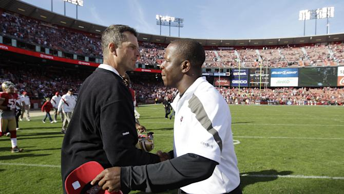 San Francisco 49ers head coach Jim Harbaugh, left, shake hands with Tampa Bay Buccaneers head coach Raheem Morris, right, after an NFL football game in San Francisco, Sunday, Oct. 9, 2011. The San Francisco 49ers defeated the Tampa Bay Buccaneers 48-3. (AP Photo/Paul Sakuma)