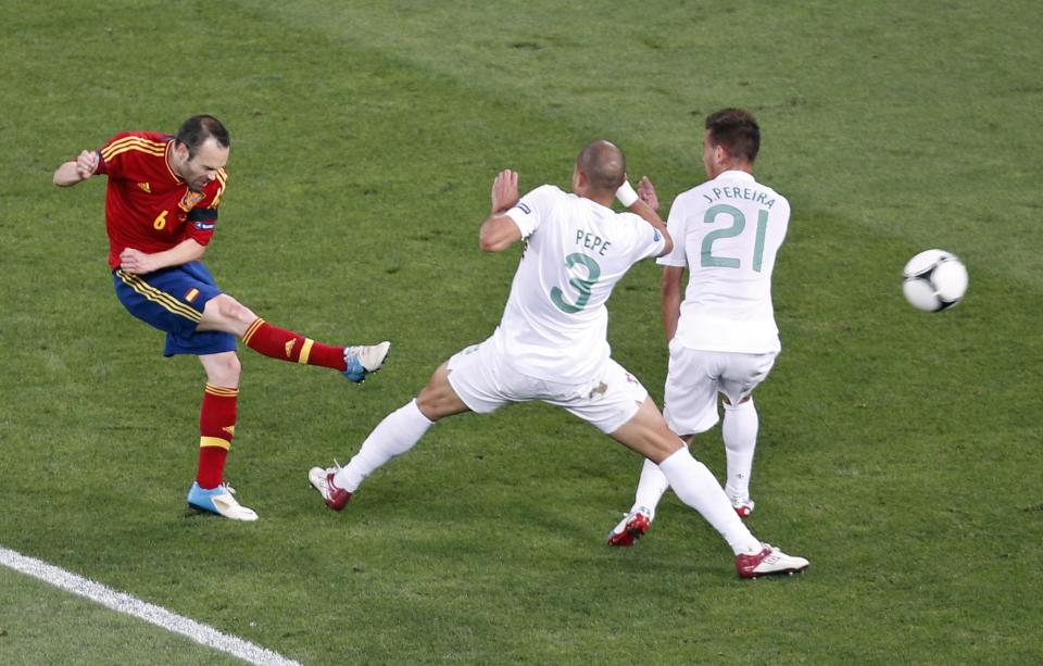 Spain's Andres Iniesta, left, fails to score past Portugal's Joao Pereira, right, and Pepe during the Euro 2012 soccer championship semifinal match between Spain and Portugal in Donetsk, Ukraine, Wednesday, June 27, 2012. (AP Photo/Darko Vojinovic)