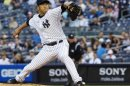 New York Yankees&#039; Kuroda pitches to the Toronto Blue Jays in their MLB American League baseball game in New York