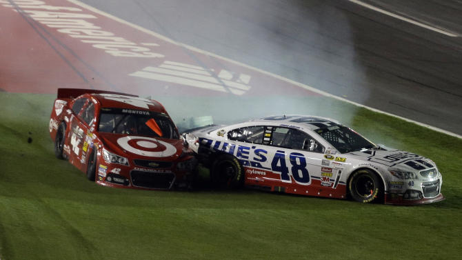 Juan Pablo Montoya (42) and Jimmie Johnson (48) collide after spinning in Turn 4 during the NASCAR Sprint Cup Series Coca-Cola 600 auto race at the Charlotte Motor Speedway in Concord, N.C., Sunday, May 26, 2013. (AP Photo/Gerry Broome)