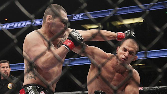Junior dos Santos, right, of Brazil, fights Cain Velasquez in the UFC mixed martial arts heavyweight title bout, Saturday, Nov. 12, 2011, in Anaheim, Calif. Dos Santos won by knockout in the first round. (AP Photo/Jason Redmond)