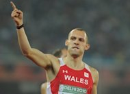 Welsh athlete Dai Greene celebrates his win during the men's 400m hurdles final at the Commonwealth Games in New Delhi in October 2010. The world 400 metres hurdles champion was selected on Monday to captain Great Britain's athletics team at the Olympics