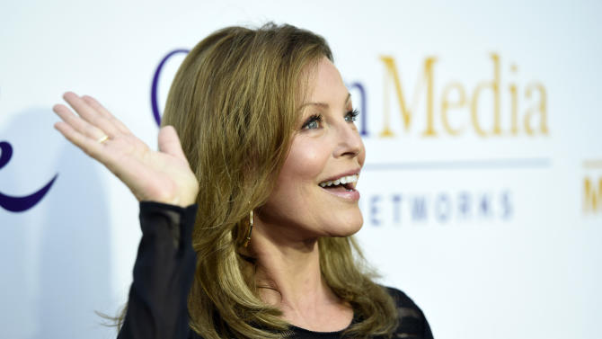 Actress Cheryl Ladd waves to photographers at the Crown Media Family Networks Television Critics Association party on Wednesday, July 29, 2015, in Beverly Hills, Calif. (Photo by Chris Pizzello/Invision/AP)
