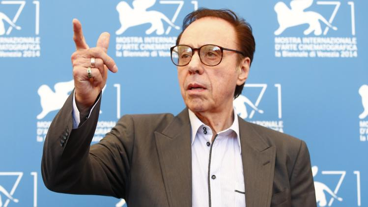 "Director Bogdanovich poses during the photo call for the movie ""She's Funny That Way"" at the 71st Venice Film Festival"
