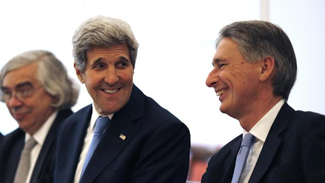 U.S. Secretary of State John Kerry, left, talks with British Foreign Secretary Philip Hammond, right, as they meet with foreign ministers from China, Germany and France at an hotel in Vienna, Austria Monday, July 6, 2015. Iran's foreign minister said on Monday some differences still remained between Iran and six powers over the country's disputed nuclear programme ahead of Tuesday's deadline for a final agreement to end a 12-year-old dispute.  (Carlos Barria/Pool Photo via AP)