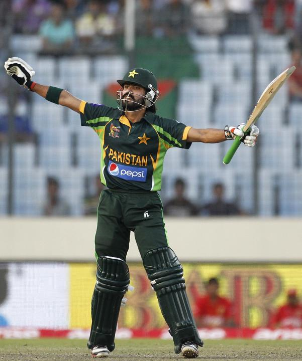 Pakistan's Fawad Alam celebrates after scoring a century against Sri Lanka during their 2014 Asia Cup final match in Dhaka