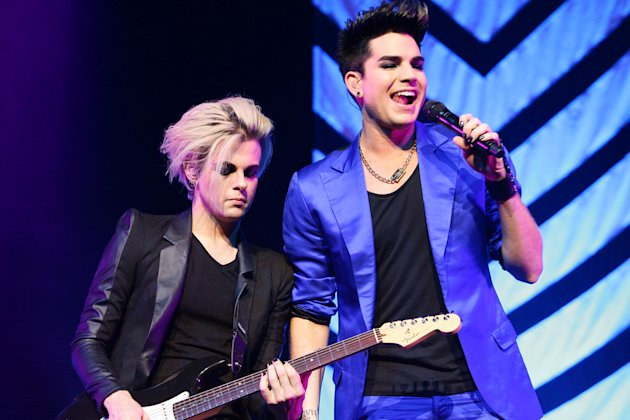 Adam Lambert, seen here with his guitarist Tommy Joe, hits back at his critics.