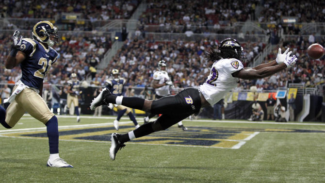 Baltimore Ravens wide receiver Torrey Smith, right, cannot reach a pass in the end zone as St. Louis Rams cornerback Justin King, left, defends during the first quarter of an NFL football game on Sunday, Sept. 25, 2011, in St. Louis. (AP Photo/Jeff Roberson)