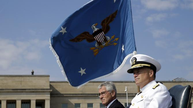 U.S. Secretary of Defense Hagel and Vice Chairman of the Joint Chiefs of Staff Admiral Winnefeld attend ceremonies marking the 2014 National POW/MIA Recognition Day at the Pentagon in Washington