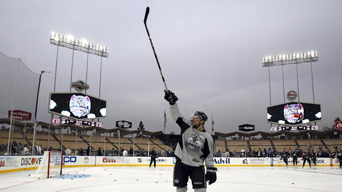 Los Angeles Kings right wing Justin Williams calls for his family to participate during family skate time after practice for the NHL Stadium Series hockey game Friday, Jan. 24, 2014, in Los Angeles. The Los Angeles Kings and the Anaheim Ducks will play outdoors at Dodger Stadium on Saturday