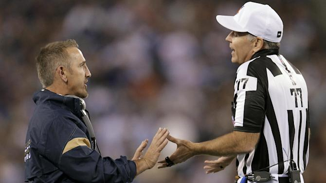 St. Louis Rams coach Steve Spagnuolo talks with referee Terry McAulay (77) during the first quarter of the Rams' NFL football game against the New York Giants on Monday, Sept. 19, 2011, in East Rutherford, N.J. (AP Photo/Julio Cortez)