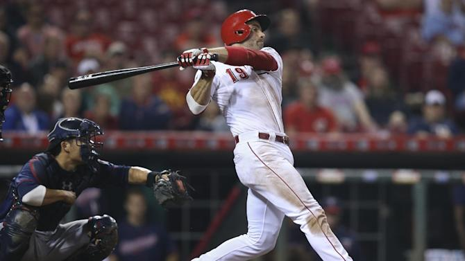Cincinnati Reds' Joey Votto hits an infield single to second to advance Billy Hamilton to third who would then score on a throwing error by Minnesota Twins second baseman Brian Dozier in the seventh inning of a baseball game, Tuesday, June 30, 2015, in Cincinnati. The Twins won 8-5. (AP Photo/John Minchillo)