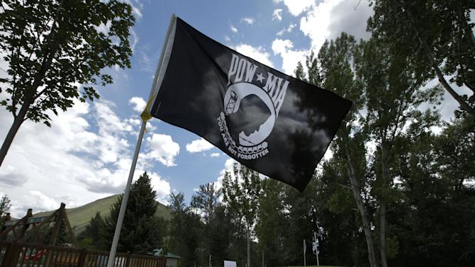 "POW-MIA flags are installed at a park in support of U.S. Army Sgt. Bowe Bergdahl, who is currently being held captive by the Taliban in Afghanistan, in Hailey, Idaho, Friday, June 21, 2013. The Afghan war, and the taking of Bergdahl, may have long faded from the minds of most Americans. But for this community in the shadow of Idaho's Sawtooth Mountains, Bowe Bergdahl and his family's fight to free him are ""omnipresent,"" said local Wesley Deklotz. ""It's a whole community of people that are keeping him in their thoughts."" (AP Photo/Jae C. Hong)"