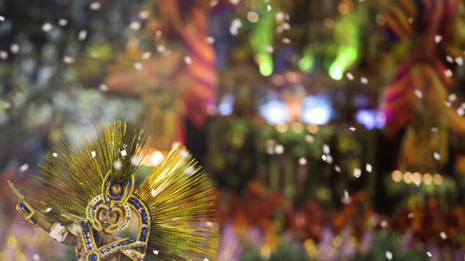 A performer from the Unidos da Tijuca samba school parades on a float during carnival celebrations at the Sambadrome in Rio de Janeiro, Brazil, early Monday, Feb. 11, 2013. (AP Photo/Felipe Dana)