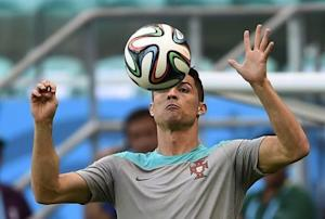Portugal's Cristiano Ronaldo controls the ball during their 2014 World Cup team training session at the Fonte Nova arena in Salvador