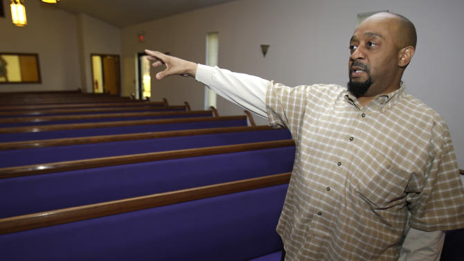 Associate Pastor Rev. Steve Sargent talks about the Sunday shooting that occurred at the Hiawatha Church of God in Christ  Monday, April 1, 2013, in Ashtabula, Ohio. Police say Reshad Riddle killed his father, Richard Riddle, with a single shot from a handgun Sunday afternoon. (AP Photo/Tony Dejak)