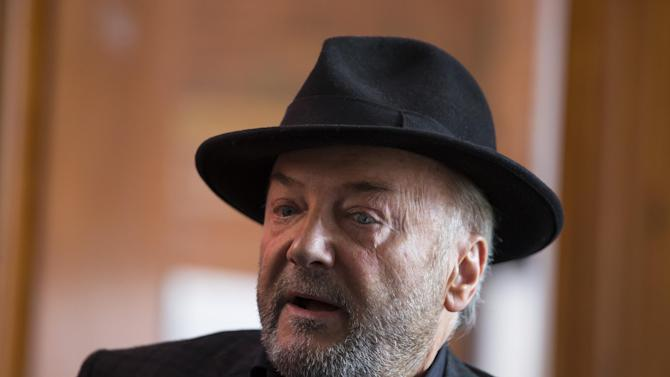 In this photo taken on Wednesday, April 22, 2015,  Respect Party Leader George Galloway speaks during an interview at his offices in the constituency of Bradford West, in Bradford, England,  as Britain's political parties campaign in the lead up to the parliamentary elections on May 7.  Anyone who thinks Britain's election is dull hasn't been to Bradford West, the campaign's wildest race, where debate ranges from local schools and services to the Israeli-Palestinian conflict, and noble rhetoric collides with character attacks. (AP Photo/Jon Super)