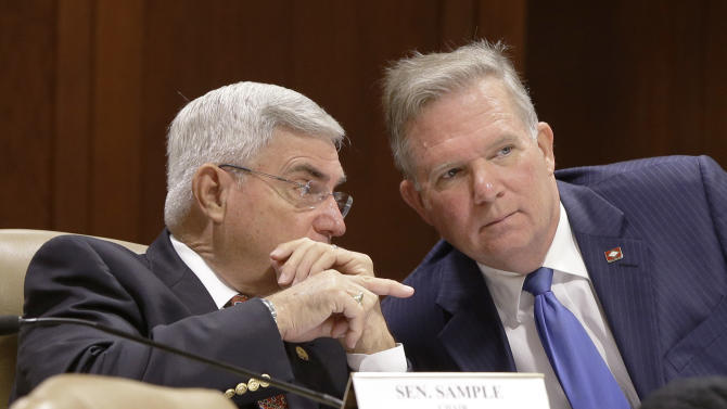 Sen. Bill Sample, R-Hot Springs, left, talks with Rep. John Edwards, D-Little Rock, in a meeting of the Joint Budget Committee at the Arkansas state Capitol in Little Rock, Ark., Wednesday, Nov. 12, 2014. The two legislators co-chair the committee. (AP Photo/Danny Johnston)
