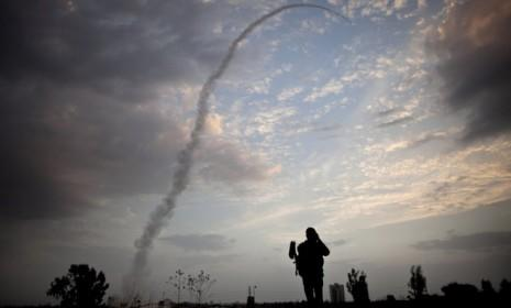 An Israeli missile from the Iron Dome defense system is launched to intercept and destroy incoming rocket fire from Gaza on Nov. 17 in Tel Aviv.