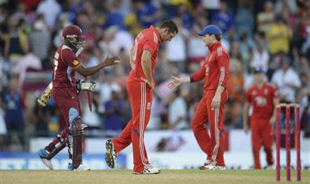 England's Bresnan reacts after the West Indies won their second T20 international cricket match in Barbados