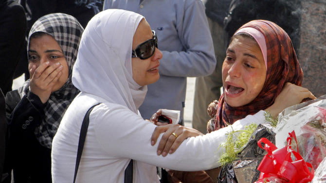 "Egyptian relatives of Mohammed Saad, a 20-year-old protester, known to his friends as ""Christi,"" who died of wounds sustained during clashes last Friday near the presidential palace, grieve during a funeral procession in Tahrir Square, Cairo, Egypt, Monday, Feb. 4, 2013. More than 60 people have died in recent protests across Egypt that began on Jan. 24, 2013, the eve of the second anniversary of the start of the uprising that toppled autocrat Hosni Mubarak. (AP Photo/Amr Nabil)"