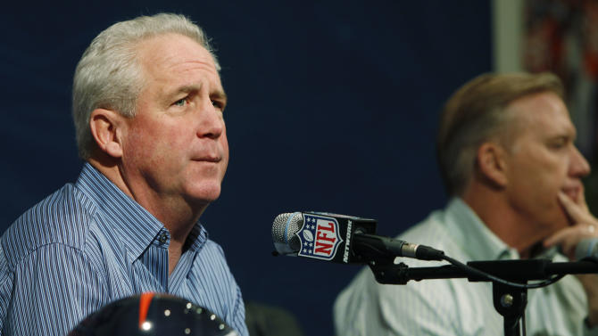 Denver Broncos head coach John Fox, front, fields a question as John Elway, the team's executive vice president of football operations, turns away during a news conference in the team's headquarters in Englewood, Colo., on Monday, Jan. 14, 2013. The team officials were meeting with reporters after the Broncos' loss to the Baltimore Ravens in an AFC Playoff game on Saturday. (AP Photo/David Zalubowski)